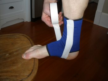 Ankle Taping 3A: Start on the inside of the ankle, wrap under the arch
