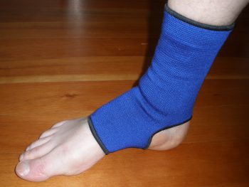 Ankle Taping: Step 1 Pre-wrap or an ankle sleeve