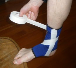 Ankle Taping: Step 3B: Continue around the ankle joint from the outside