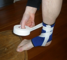 Ankle Taping: Step 3C: Wrap tape 1-2 times around the leg above the ankle joint